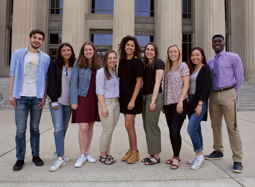 Nine students from the first Applebaum fellows cohort standing together in front of Angell Hall.