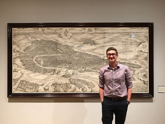 Student in front of 1500 map of Venice, Italy