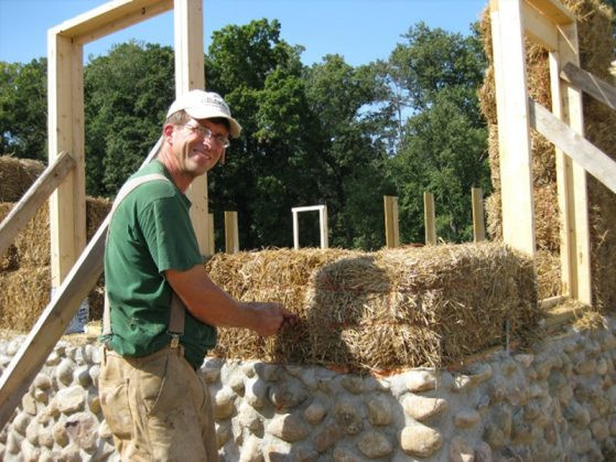 Course co-instructor Joe Trumpey working on a strawbale building
