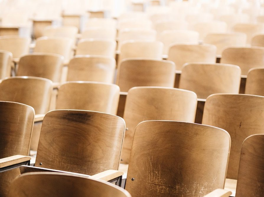 Rows of empty chairs in a lecture hall