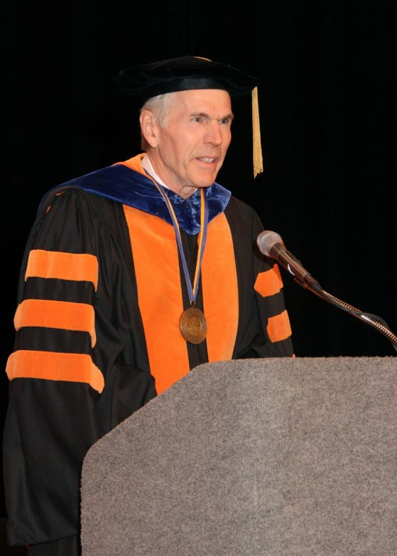 Cook in academic regalia