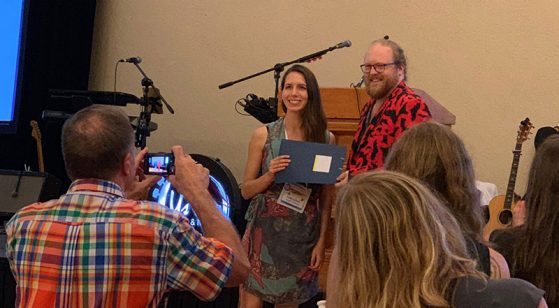 Nate Fuller, a member of the Board of Directors of the North American Society for Bat Research, presents the Luis F. Bacardi Bat Conservation Award to Giorgia Auteri in Puerto Vallarta, Mexico.