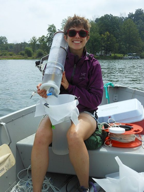 Marian Schmidt sampling water on Bristol Lake near Battle Creek, Mich. to see how bacterial community composition varies with lake productivity levels.