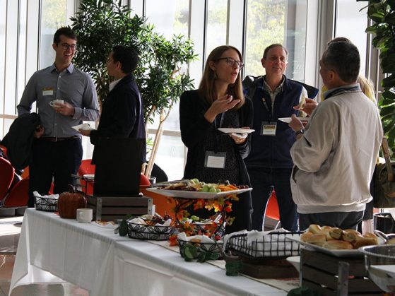 Symposium attendees and speakers share ideas during the morning break.