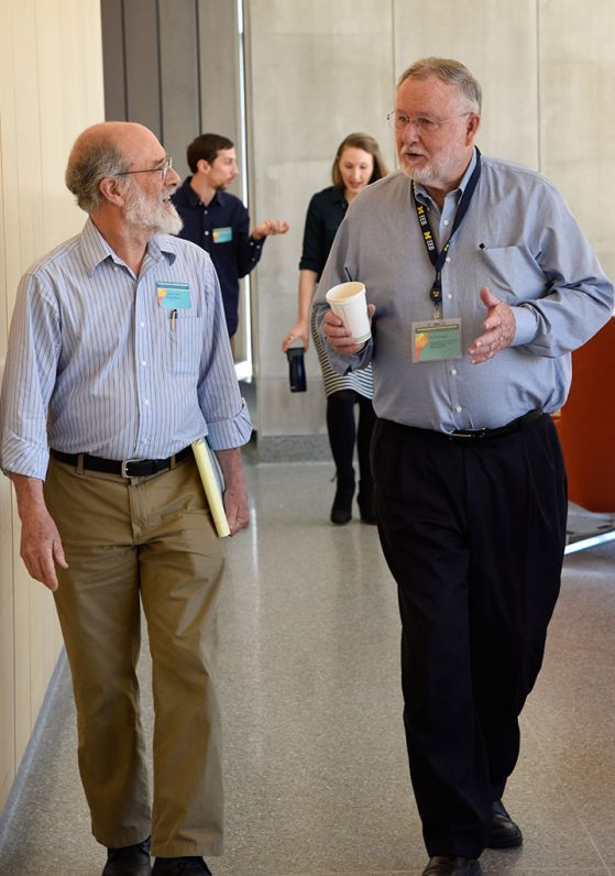 Dan Fisher and Jim Ehleringer discuss research questions, walking together.
