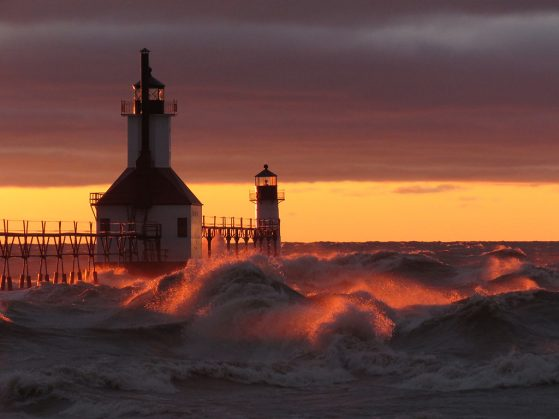 "First place goes to Teresa Pegan, EEB's new Photographer at Large for 2021- 2022 for ""Waves from an Alberta clipper at sunset,"" St. Joseph, Mich. Lighthouse at sunset with large waves surrounding it."