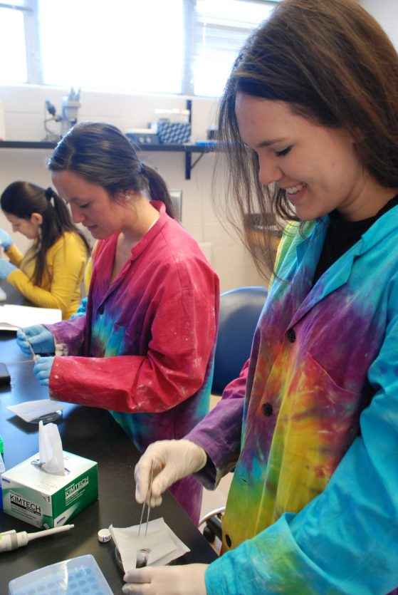 Victoria Zakrzewski (front) and Natalie Greenhalgh work in the lab.