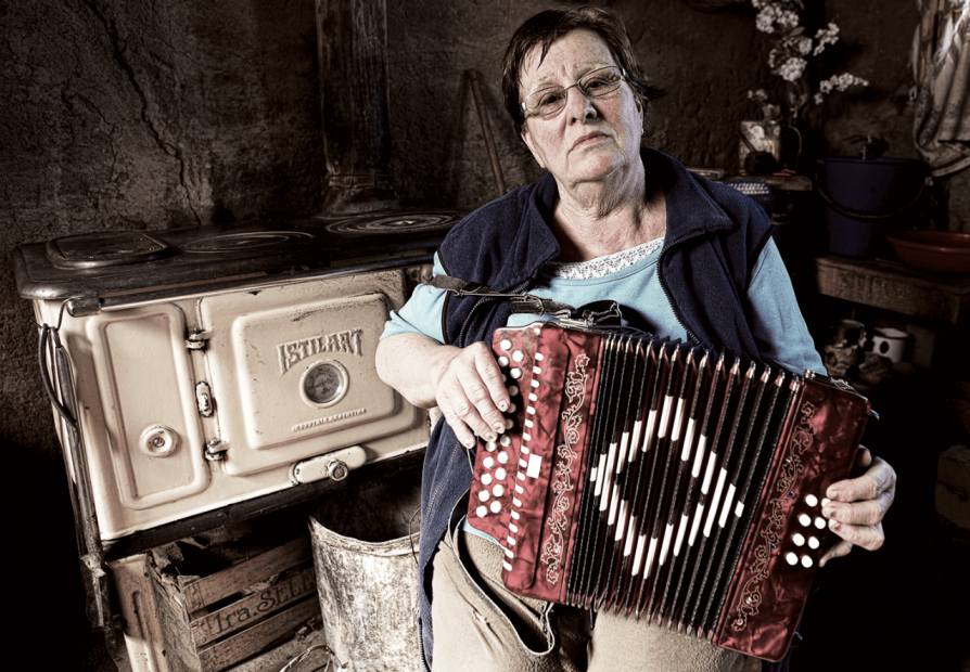 A member of the Afrikaans-speaking community holding an accordion.