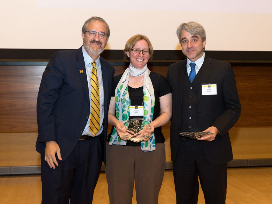 President Mark Schlissel with the recipients of the first President's Award for Public Impact, Meghan Duffy and Arthur Lupia.